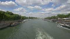 Sightseeing boat floating on Seine River on a cloudy day, Paris - stock footage