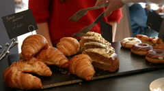 Stock Video Footage of Waitress serving a croissant to customer