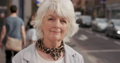 Slow Motion Portrait of happy mature old woman smiling - stock footage