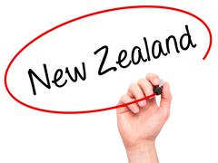 Man Hand writing New Zealand with black marker on visual screen Stock Photos