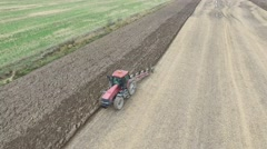 4k aerial tractor plows closeup Stock Footage