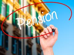 Man Hand writing Pension with black marker on visual screen - stock photo