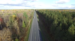 4k aerial transport passes under drone beautiful backroads - stock footage
