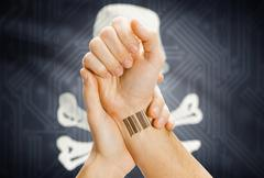 Barcode ID tattoo on hand and Jolly Roger flag on background - symbol of pira Stock Photos