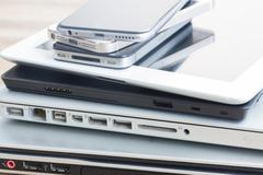 pile of devices - stock photo