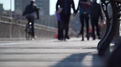 Pedestrians walking on a bridge Stock Footage