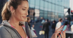 Slow Motion Portrait of happy beautiful fitness woman using smart phone - stock footage