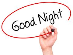 Man Hand writing Good Night with black marker on visual screen Stock Photos