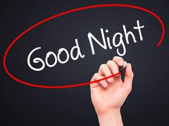 Man Hand writing Good Night with black marker on visual screen - stock photo