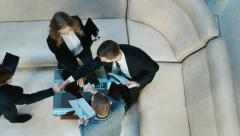 Meeting business partners. Handshake view from above Stock Footage