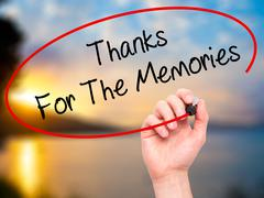 Man Hand writing Thanks For The Memories with black marker on visual screen Stock Photos