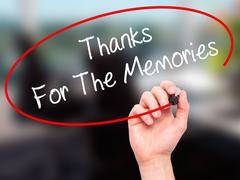 Man Hand writing Thanks For The Memories with black marker on visual screen - stock photo