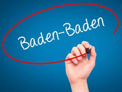 Man Hand writing Baden-Baden with black marker on visual screen. - stock photo