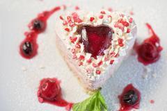 Heart-shaped valentine cake Stock Photos