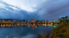 Timelapse of clouds over Portland OR skyline along Willamette River at blue hour Stock Footage