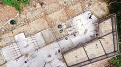 Aerial view on construction of concrete buildings of villa in jungle Stock Footage