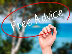 Man Hand writing Free Advice with black marker on visual screen. Stock Photos