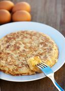 Potato omelette on a plate - stock photo