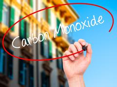 Man Hand writing Carbon Monoxide with black marker on visual screen. - stock photo