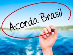 Hand writing Acord Brasil (Wake Up Brazilin Portuguese) with marker - stock photo