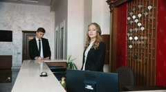 Check into a hotel. Businessmen filled with documents at the reception of the Stock Footage