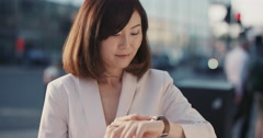 Slow Motion Portrait of happy beautiful Japanese woman using smart watch - stock footage