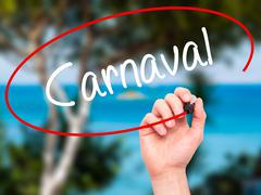 Man Hand writing Carnaval with black marker on visual screen. Stock Photos
