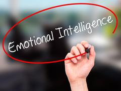 Stock Photo of Man Hand writing Emotional Intelligence with black marker on visual screen.