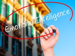 Man Hand writing Emotional Intelligence with black marker on visual screen. - stock photo