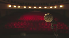 Microphone stands in front of seats in theatre. Stock Footage