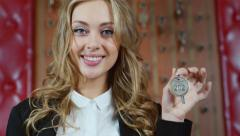 Friendly woman administrator at smiling and showing your room key Stock Footage