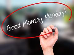 Man Hand writing Good Morning Monday! with black marker on visual screen. - stock photo