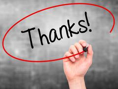 Man Hand writing Thanks! with black marker on visual screen. - stock photo