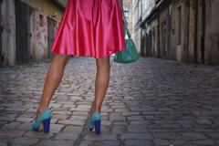 Caucasian woman wearing heels in alleyway Stock Photos