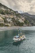 Stock Photo of Boat sailing near Positano cityscape, Amalfi Peninsula, Italy