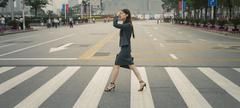 Chinese businesswoman in pedestrian crossing Stock Photos