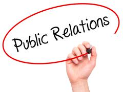 Man Hand writing Public Relations with black marker on visual screen. Stock Photos