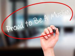 Man Hand writing Proud to Be A Muslim with black marker on visual screen. Stock Photos