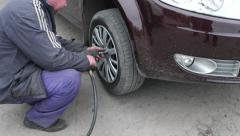 Tire Service loosening screws pneumatic screwdriver to remove the wheels - stock footage