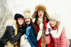 Caucasian girls playing with disguises in snow Stock Photos