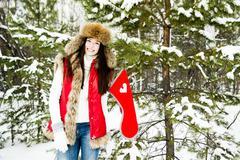 Caucasian girl hanging Christmas stocking on snowy tree Stock Photos