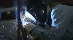 Female Welder Assembles Steel frame in Industrial Metal Shop Stock Footage