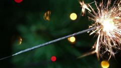 Last minute sparklers on the background of Christmas garland, HD 1920х1080 Stock Footage