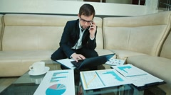 Businessman immersed in work Stock Footage