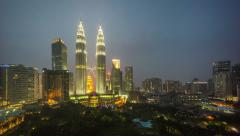 Day to night cloudy hazy sunset at Kuala Lumpur City Centre Stock Footage