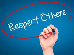 Man Hand writing Respect Others with black marker on visual screen. - stock photo