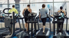 People are trained on a treadmill. In the picture, there is no recognizable Stock Footage