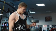 The athlete trains muscles biceps Stock Footage