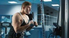 The athlete trains the triceps muscle on the block - stock footage