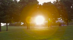 people walking park at sunset - stock footage